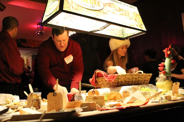 Jesuits and dames in fur hats around the Cheese Board in 2012