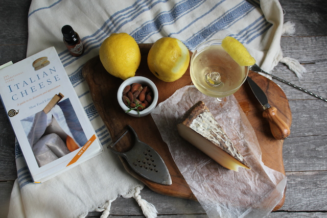 Sicilian cheese and a briny Astoria Cocktail from The New Cocktail Hour book